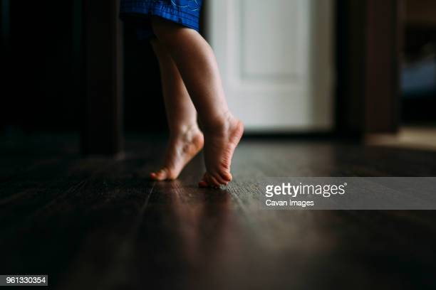 Low section of boy tiptoeing