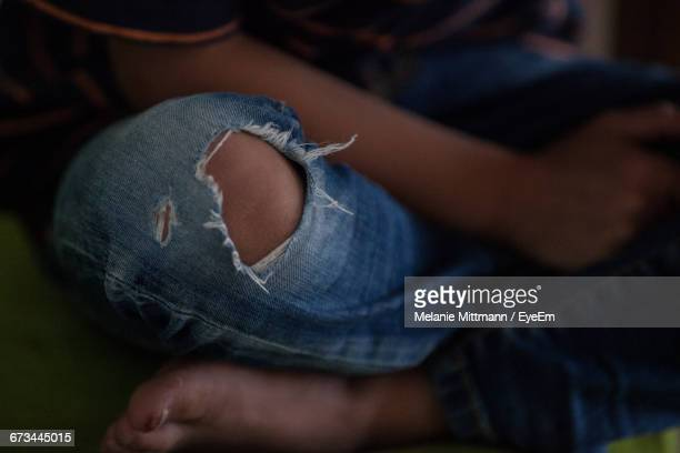 Low Section Of Boy Wearing Torn Jeans