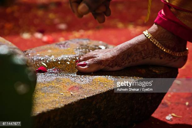 Low Section Of Bride Wearing Gold Anklet During Wedding