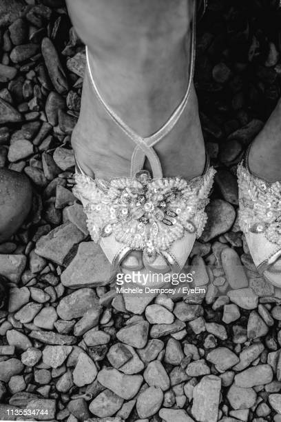 low section of bride wearing high heels on gravel - high heels stock pictures, royalty-free photos & images
