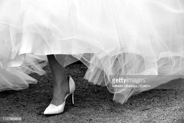 low section of bride wearing high heels - marriage stock pictures, royalty-free photos & images