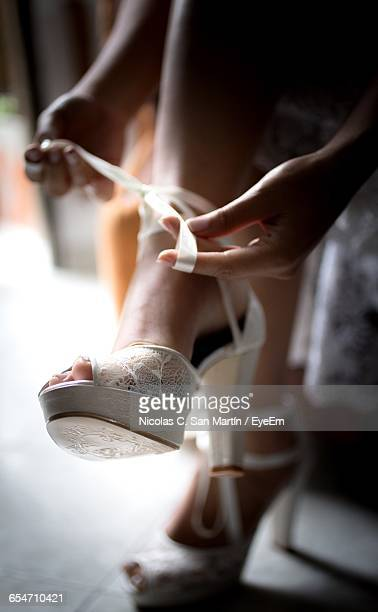 Low Section Of Bride Wearing High Heels