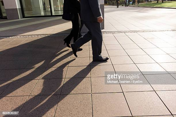 Low Section Of Business People Walking On Footpath