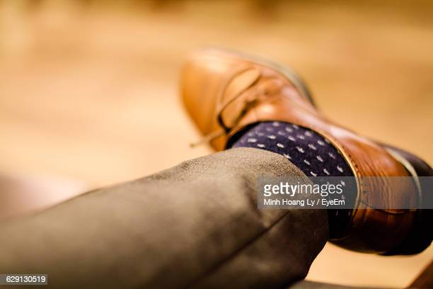 Low Section Of Businessman Wearing Brown Shoe