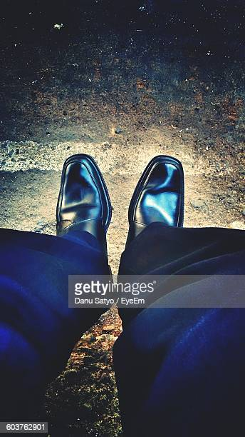 Low Section Of Businessman Wearing Formal Shoes On Street