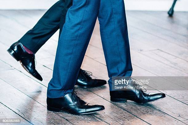 Low Section Of Businessmen Walking On Floorboard