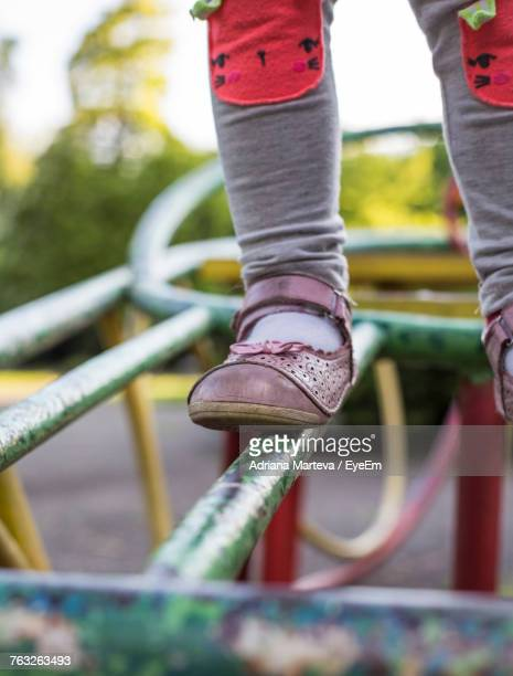 low section of child on outdoor play equipment - ジャングルジム ストックフォトと画像
