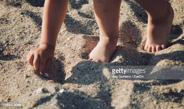 Low Section Of Child On Sand At Beach
