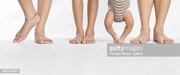 Low Section Of Children Against White Background