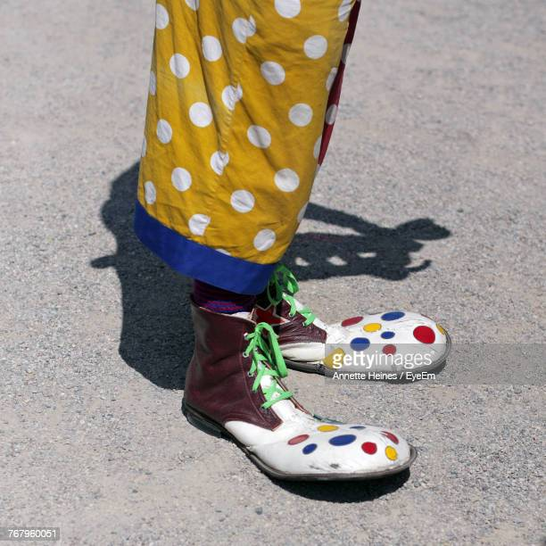 Low Section Of Clown Standing On Road