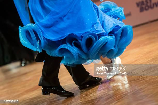 low section of couple dancing on hardwood floor - ballroom dancing stock pictures, royalty-free photos & images