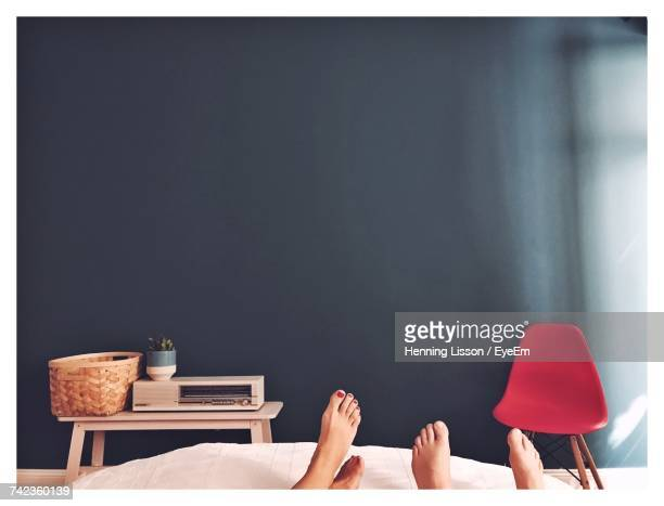 Low Section Of Couple In Bed