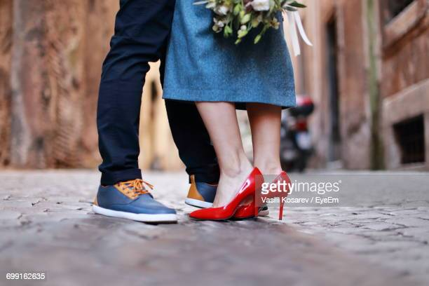 low section of couple kissing - leg kissing stock photos and pictures