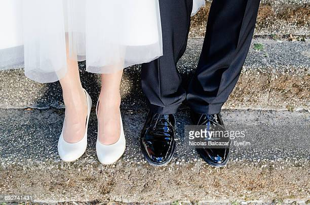 Low Section Of Couple On Wedding Day