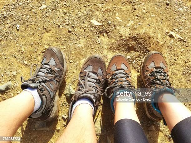 low section of couple outdoors - cuenco stock photos and pictures