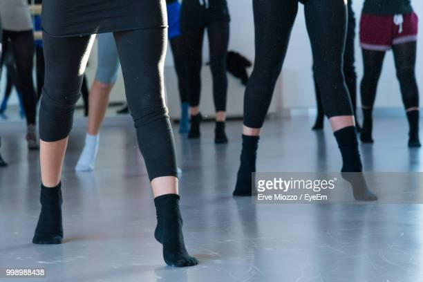 Low Section Of Dancers Practicing In Studio