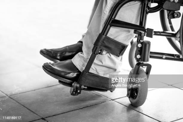 low section of disabled person on wheelchair - 麻痺 ストックフォトと画像