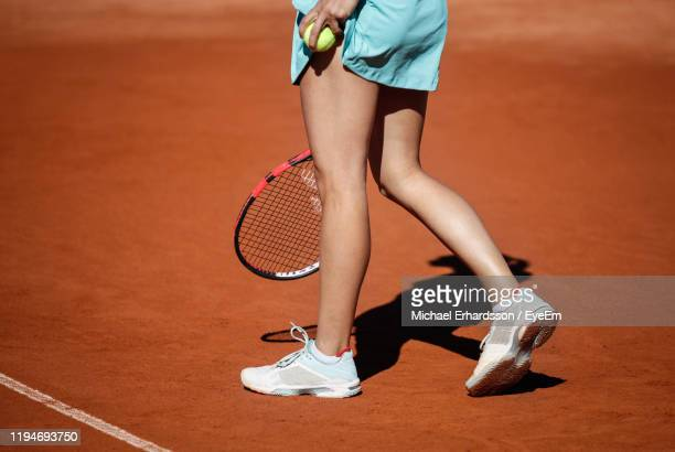 low section of female tennis player on field - tennis stock pictures, royalty-free photos & images