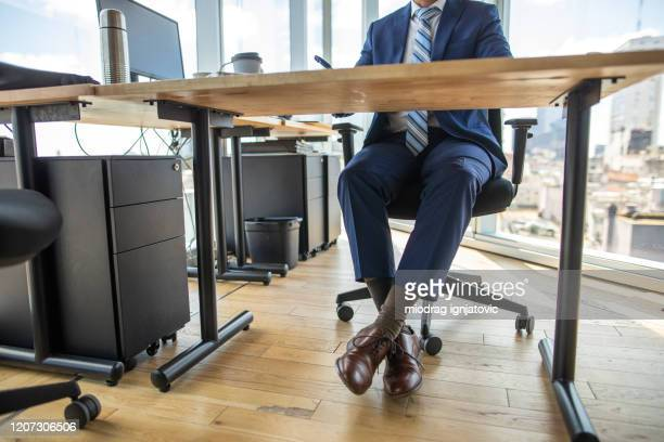 low section of formal dressed businessman in office - low section stock pictures, royalty-free photos & images