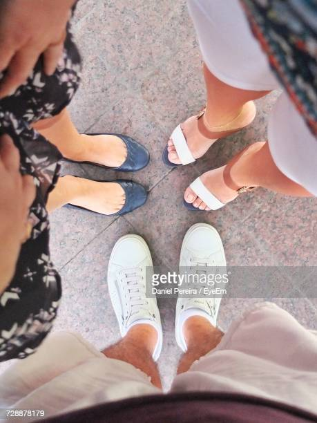 Low Section Of Friends Standing On Sidewalk