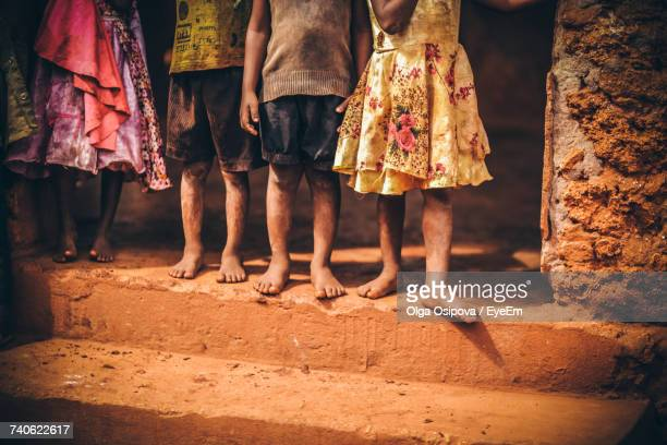 Low Section Of Friends Standing On Street