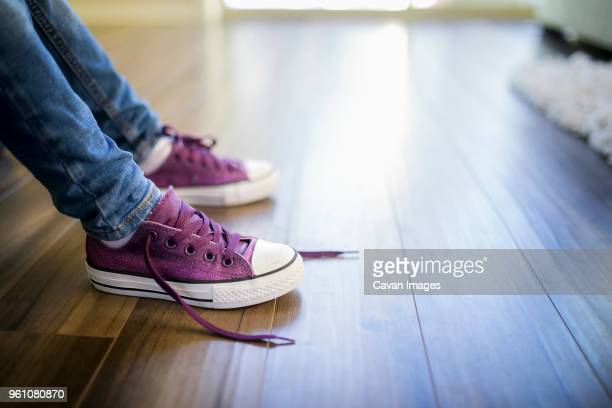low section of girl at home - purple shoe stock pictures, royalty-free photos & images