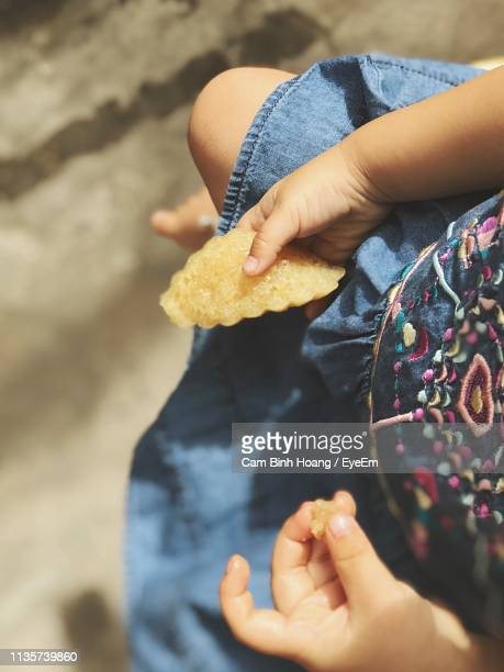 Low Section Of Girl Having Food Outdoors