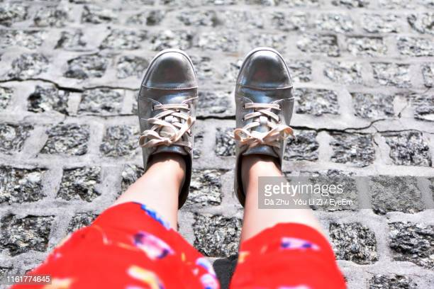 low section of girl on footpath - low section stock pictures, royalty-free photos & images