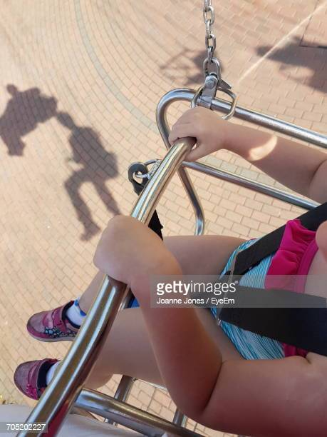 Low Section Of Girl Sitting In Rollercoaster