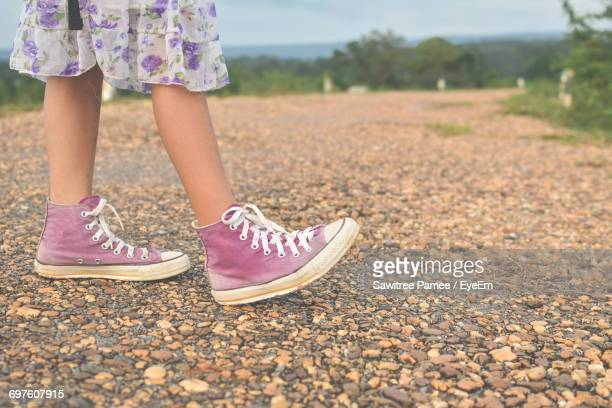 Low Section Of Girl Walking In Summer