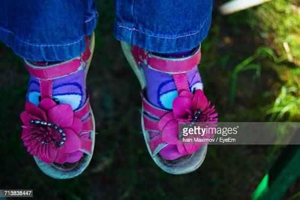 Low Section Of Girl Wearing Pink Sandals