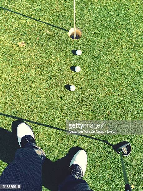 Low Section Of Golfer On Golf Course
