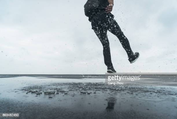 low section of jumping in splashing water - parte inferior imagens e fotografias de stock