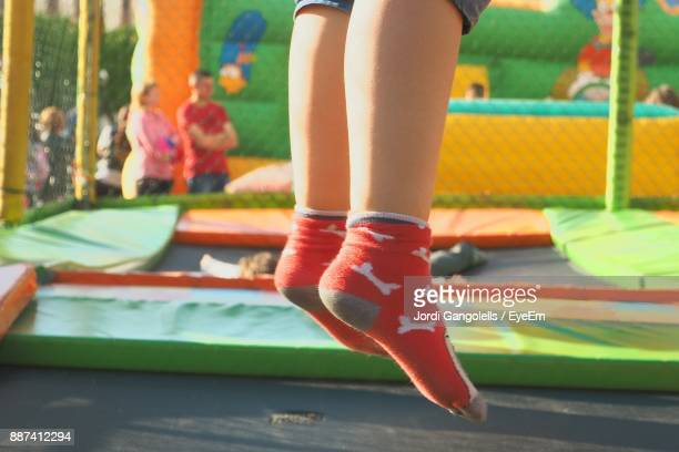 Low Section Of Kid Jumping On Bouncy Castle