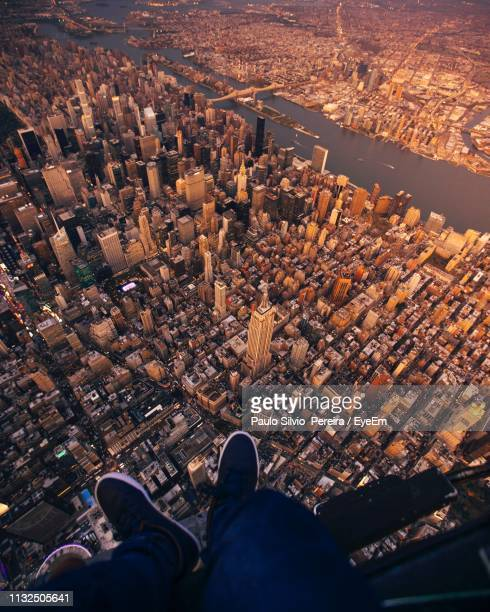 low section of man above cityscape - human foot stock pictures, royalty-free photos & images