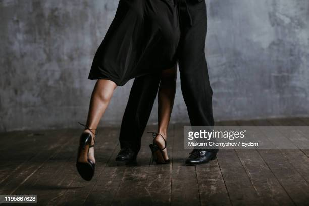 low section of man and woman dancing on floor - ballroom stock pictures, royalty-free photos & images