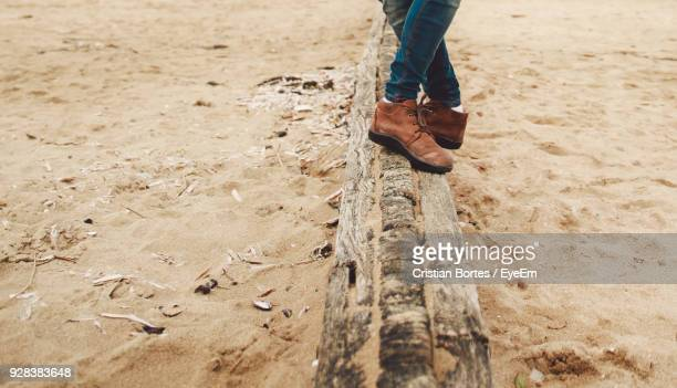 low section of man at beach - bortes stock pictures, royalty-free photos & images