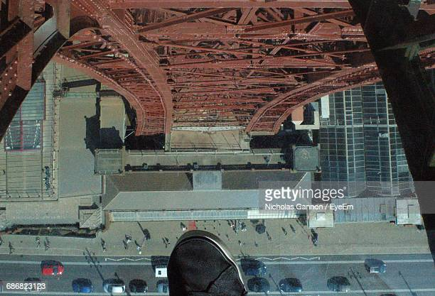 Low Section Of Man At Blackpool Tower With Street Seen Through Glass