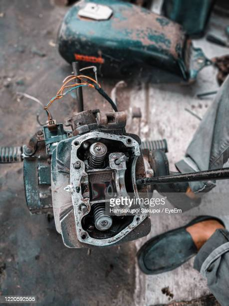 low section of man by old vehicle part - hamsakupoi stock pictures, royalty-free photos & images