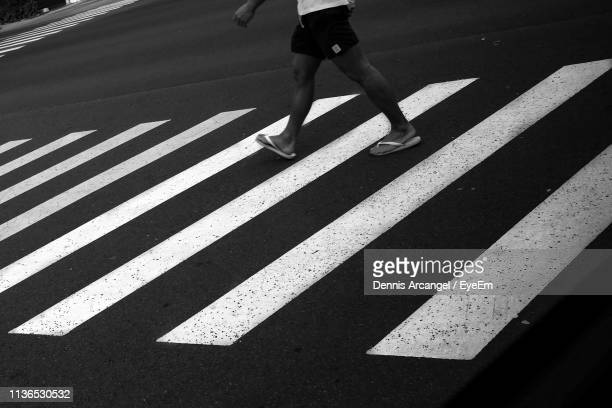 Low Section Of Man Crossing Road
