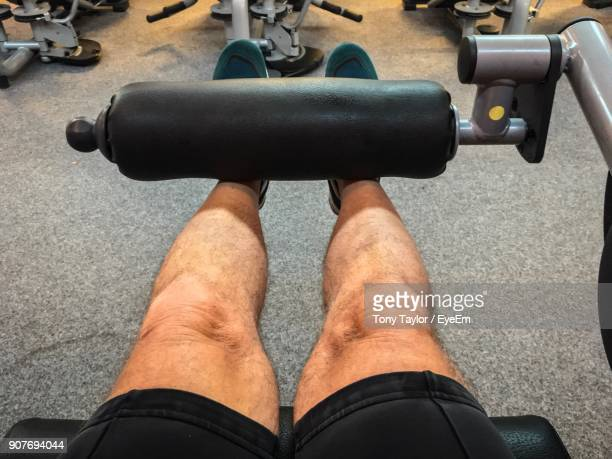 Low Section Of Man Exercising In Gym