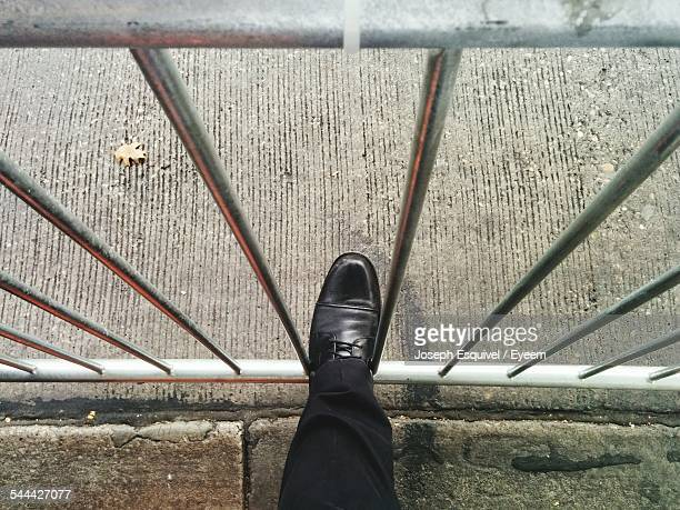 Low Section Of Man Foot On Railing