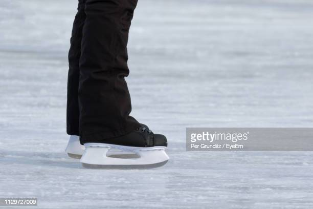 Low Section Of Man Ice-Skating On Rink