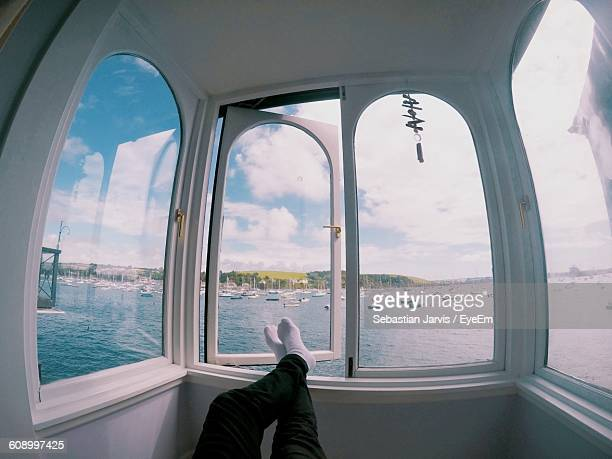 Low Section Of Man In Boat Sailing On Sea