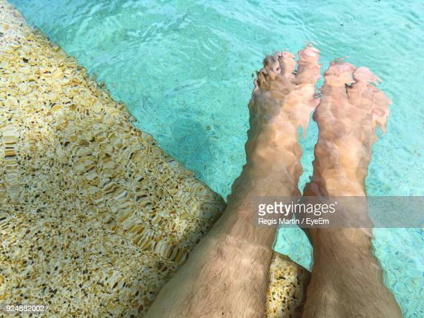 low section of man in swimming pool - menselijke ledematen stockfoto's en -beelden