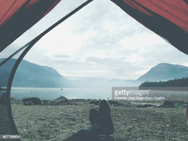 Low Section Of Man In Tent At Lakeshore