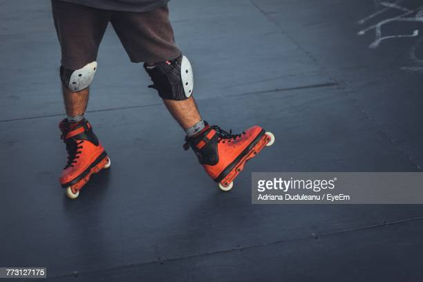 low section of man inline skating - inline skate stock photos and pictures