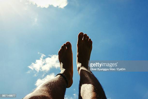 Low Section Of Man Legs Against Sky