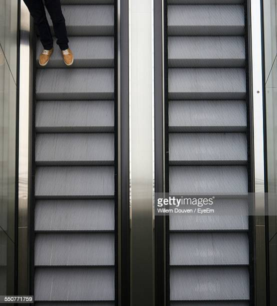 low section of man on escalator - building feature stock pictures, royalty-free photos & images