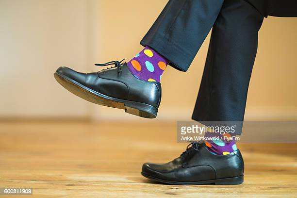 low section of man on floor - purple shoe stock pictures, royalty-free photos & images